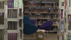 Library room with books racks librarian Stock Footage