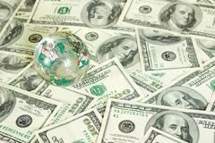 Globe on dollars Stock Photos