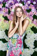 Girl in flowers. Stock Photos