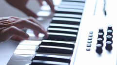 Synthesizer player close up Stock Footage