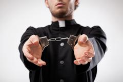 Priest handcuffed Stock Photos