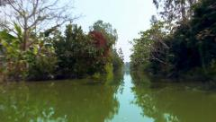 Rainforest river boat trip on Mekong Delta canal Vietnam. Fast motion time lapse Stock Footage
