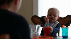 Toddler and mother eating breakfast at table Stock Footage