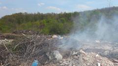 Illegal garbage dump. various trash is burning Stock Footage