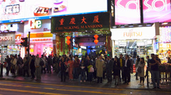 Hong Kong downtown Nathan Road commuters zebra crossing crowds crowded China Stock Footage