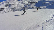Stock Video Footage of  Turning snowboard in Val Thorens