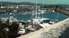 Europe Spain Balearic Ibiza Eivissa city 184 city wall, harbor and a cannon Stock Footage