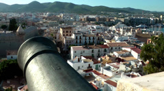 Europe Spain Balearic Ibiza Eivissa city 183 harbor district behind a cannon Stock Footage
