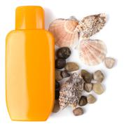lotion and some pebble and shells - stock photo