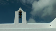 Europe Spain Balearic Ibiza towns and villages 188 moving clouds over church Stock Footage