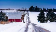 Red barn along a country road in rural adams county, maryland. Stock Photos