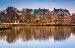 Reflections of waterfront buildings along the potomac river in alexandria Stock Photos