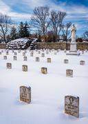 Snow covered cemetary at the national shrine of saint elizabeth ann seton  Stock Photos