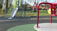 A round about spinning at an empty playground Stock Footage