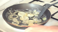 Onions frying in hot pan Stock Footage
