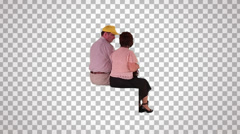 Man & woman sitting on spectator seats (rear view) Stock Footage