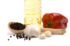 paprika, garlic, black pepper and oil - stock photo