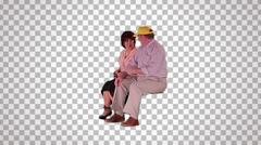 Man & woman sitting on spectator seats Stock Footage