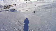 Skiing shadow in Val Thorens Stock Footage