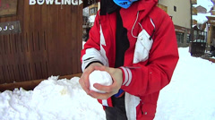 Throwing a snowball Stock Footage