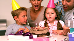 Happy family celebrating a birthday together Stock Footage