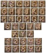 alphabet letters and numbers made from wine corks - stock photo