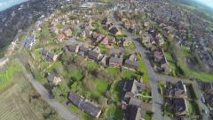 Aerial view over housing estate in Cheshire uk - stock footage