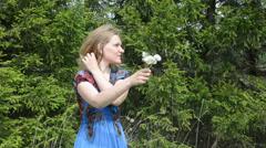 Woman shake dandelion flowers seeds fly wind Stock Footage
