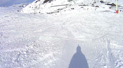Skiing under the skilift in Val Thorens Stock Footage