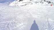 Stock Video Footage of Skiing under the skilift in Val Thorens