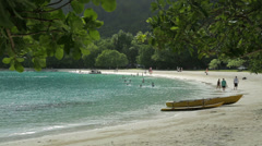 outrigger canoe on tropical beach with tourists, champagne bay, vanuatu - stock footage