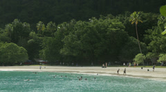 Tourists on tropical beach at champagne bay, vanuatu Stock Footage