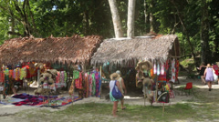 Tourists from cruise ship shop for souvenirs, champagne bay, vanuatu Stock Footage