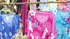 Local colorful dresses for sale to tourists, champagne bay, vanuatu Stock Footage