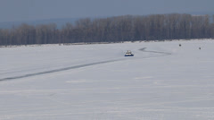 Hovercraft crossing frozen river Stock Footage