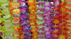 Flower leis on sale for tourists from cruise ship, champagne bay, vanuatu Stock Footage