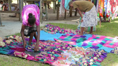 Local women display souvenir for tourists, champagne bay, vanuatu Stock Footage