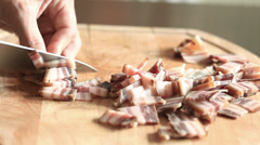 Bacon slicing and moving away from chopping board Stock Footage