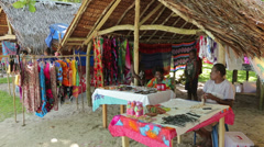 Local people sell souvenirs from beach hut, champagne bay, vanuatu Stock Footage