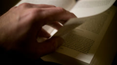 Turning book pages - stock footage