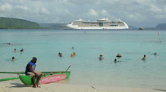Cruise ship in bay with tourists swimming, champagne bay, vanuatu Stock Footage