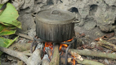 Cooking pots boiling lobster on beach, champagne bay, vanuatu Stock Footage