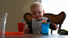 Toddler eating breakfast at the table Stock Footage
