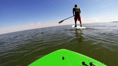 4K ULTRA HD Man paddleboarding in Tampa Bay Stock Footage