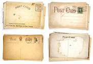 Stock Photo of four stacks of blank, vintage postcards
