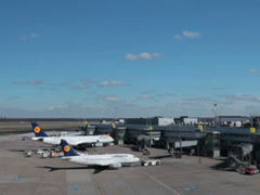 Tow tractor pushing lufthansa jet airplane on dusseldorf airport. Stock Footage