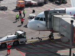 tow tractor docking to airberlin airplane jet on dusseldorf airport apron. - stock footage