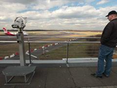 People watching airplanes on dusseldorf airport tower viewer Stock Footage