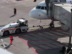 Tow tractor docking to airberlin airplane jet on dusseldorf airport apron. Stock Footage