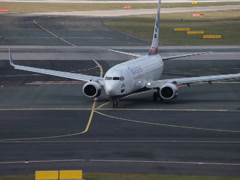 Sunexpress airlines boeing 737-8hc jet plane tc-snu taxiing dusseldorf airpor Stock Footage